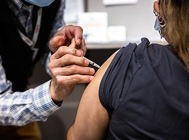 Mass Eye and Ear staff member getting vaccine